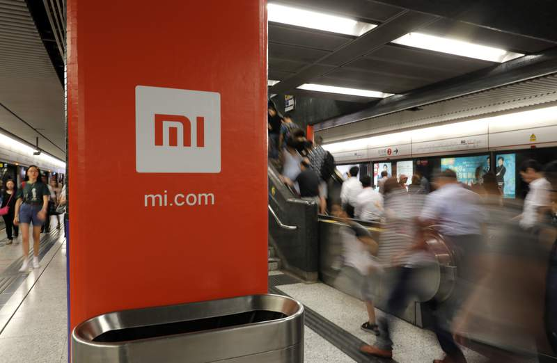 FILE - In this July 9, 2018, file photo, an advertisement for Xiaomi is displayed at a subway station in Hong Kong. Chinas commerce ministry said Thursday that the removal of Xiaomi Corp. from a U.S. government blacklist was beneficial, a day after the U.S. reversed a ban on U.S. investments in the smartphone maker imposed by former President Donald Trump. (AP Photo/Vincent Yu, File)