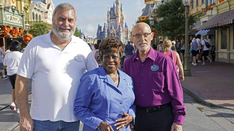 Walt Disney World employees Chuck Milam, Earliene Anderson and Forrest Bahruth gathered at the Magic Kingdom in Lake Buena Vista last month to celebrate their 50 years working at the park.