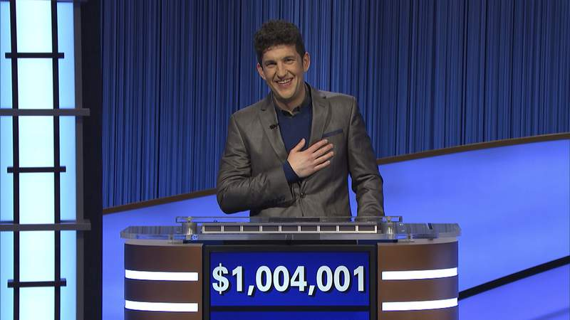 This photo provided by Jeopardy Productions Inc. shows Jeopardy! contestant Matt Amodios after his total win amount was announced, Friday, Sept. 24, 2021.  Amodio, a fifth-year computer science Ph.D student at Yale University, won $48,800 for his 28th victory, bringing his total winnings to $1,004,001. (Jeopardy Productions Inc. via AP)