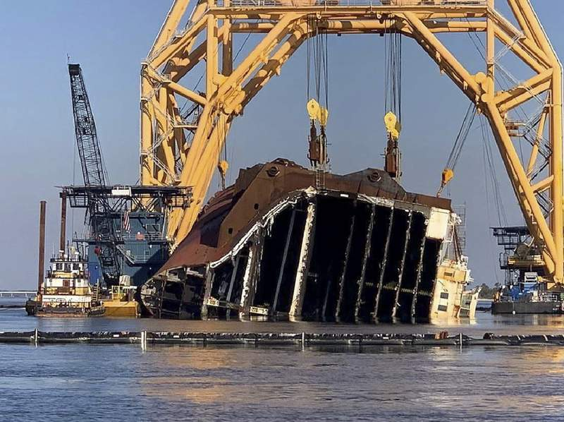 FILE - In this Feb. 25, 2021 photo, a towering crane straddles the capsized cargo ship Golden Ray, its interior decks exposed after the ship's bow was cut off and hauled away, off the coast of St. Simons Island, Ga. Salvage crews began Nov. 6 cutting the ship into giant chunks for removal. The vessel has been beached on its side since it overturned Sept. 8, 2019, soon after leaving port. (St. Simons Sound Incident response photo by Farrell Lafont of Gallagher Marine Systems via AP)