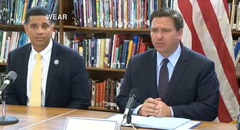 Florida Gov. Ron DeSantis and Marcus Chambers, Superintendent of Okaloosa County Schools.