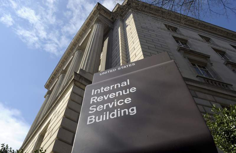 FILE - In this photo March 22, 2013 file photo, the exterior of the Internal Revenue Service (IRS) building in Washington. Lawmakers are increasingly looking at boosting the IRS to help pay for infrastructure improvements. (AP Photo/Susan Walsh, File)