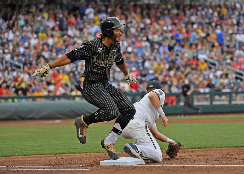 Austin Martin of Vanderbilt tries to beat a throw to first base in the third inning against the Michigan Wolverines during game two of the College World Series Championship Series on June 25, 2019 at TD Ameritrade Park Omaha in Omaha, Nebraska.  (Photo by Peter Aiken/Getty Images)