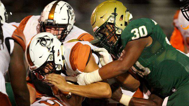 Fleming Island linebacker Jourdan Haynes (30) tackles Atlantic Coast quarterback Ridge Jacobs in the second quarter of a Week 10 game last year. Fleming Island won the game 41-17. (Ralph D. Priddy, Contributed photo)