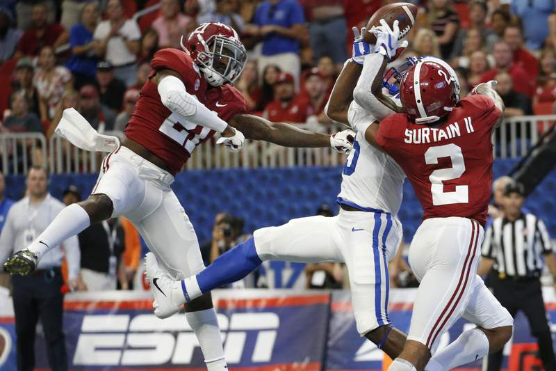 FILE - Alabama defensive backs Jared Mayden (21) and Patrick Surtain II (2) break up a pass intended for Duke wide receiver Jalon Calhoun (5) during the first half an NCAA college football game in Atlanta, in this Saturday, Aug. 31, 2019, file photo. The Cowboys should have their choice of cornerbacks after losing starter Chidobe Awuzie to Cincinnati in free agency, possibly grabbing his replacement to start alongside 2020 second-round choice Trevon Diggs. Former Alabama teammate Patrick Surtain II is a popular name in mock drafts.(AP Photo/John Bazemore, File)