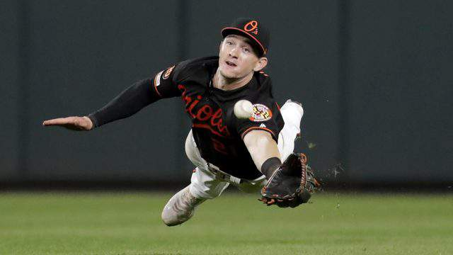 Baltimore Orioles center fielder Austin Hays, a JU product,makes a diving catch on a ball hit by Seattle Mariners' Omar Narvaez during the ninth inning of a Sept. 20 game. (AP Photo/Julio Cortez)