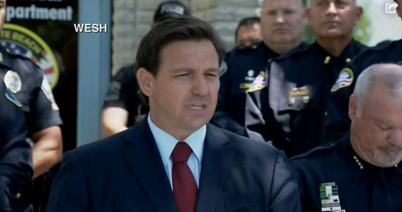 Gov. Ron DeSantis holds a news conference in front of the Satellite Beach Police Department.