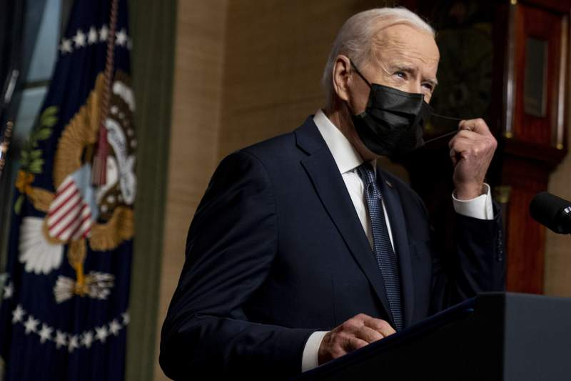 FILE - In this Wednesday, April 14, 2021, file photo, President Joe Biden removes his mask to speak at a news conference at the White House, in Washington. Ten liberal senators are urging Biden to back India and South Africas appeal to the World Trade Organization to temporarily relax intellectual property rules so coronavirus vaccines can be manufactured by nations that are struggling to inoculate their population. (AP Photo/Andrew Harnik, Pool, File)
