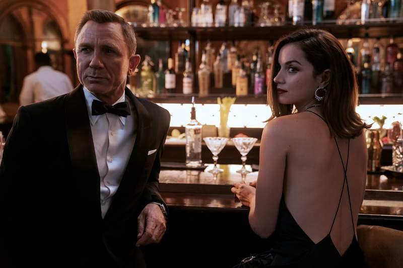 "James Bond (Daniel Craig) and Paloma (Ana de Armas) in ""No Time to Die."" (Photo by: Nicola Dove)"