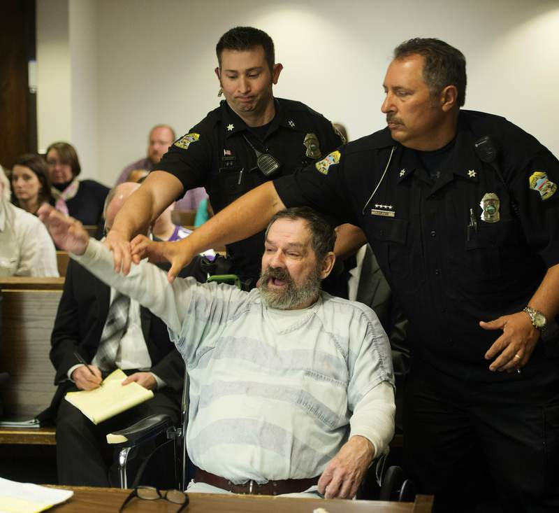 FILE - In this Nov. 10, 2015, file photo, Frazier Glenn Miller Jr., convicted of capital murder, attempted murder and other charges, gestures as Johnson County deputies remove Miller from the courtroom during the sentencing phase of his trial at the Johnson County District Court in Olathe, Kan. Miller, an avowed anti-Semite who fatally shot three people at Jewish sites in Kansas has died in prison, Monday, May 3, 2021, at the El Dorado Correctional Facility. (Joe Ledford/The Kansas City Star via AP, Pool, File)