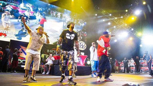 Actual members of the Wu-Tang Clan perform during a concert (AP Image)