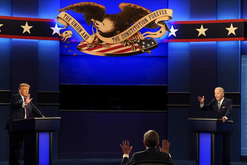Moderator Chris Wallace of Fox News as well as President Donald Trump and Democratic candidate former Vice President Joe Biden during the first presidential debate Tuesday, Sept. 29, 2020, at Case Western University and Cleveland Clinic, in Cleveland, Ohio. (AP Photo/Patrick Semansky)