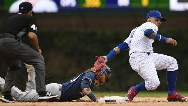 Milwaukee's Ben Gamel, a Bishop Kenny product, slides safely into second base as Cubs shortstop Javier Baez, an Arlington Country Day product, attempts to apply the tag during the ninth inning of a baseball game on Aug 31. (AP Photo/Paul Beaty)