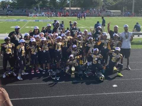 Members of the Forestview Outlaws mitey mite Pop Warner celebrate after a win this season. The Outlaws and the Westside Wildcats are both playing in the championship games of the Mid-America/Southeast event on Dec. 9.