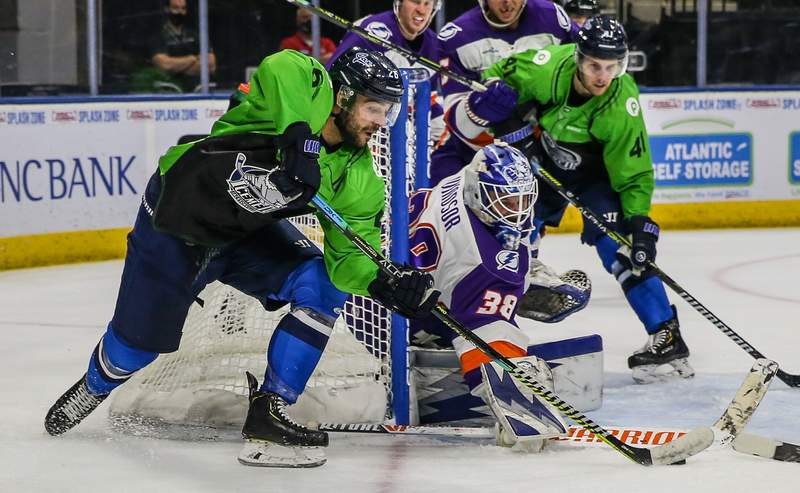 Jacksonville Icemen forward Pascal Aquin (26) looks for an opening to score against Orlando Solar Bears goaltender Clint Windsor (38) during the second period of an ECHL hockey game at Veterans Memorial Arena in Jacksonville, Fla., Sunday, Feb. 28, 2021.  [Gary Lloyd McCullough/For the Jacksonville Icemen]