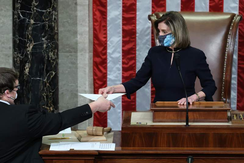 Speaker of the House Nancy Pelosi (D-CA) presides over the vote to impeach U.S. President Donald Trump for the second time in little over a year in the House Chamber of the U.S. Capitol Jan. 13, 2021.