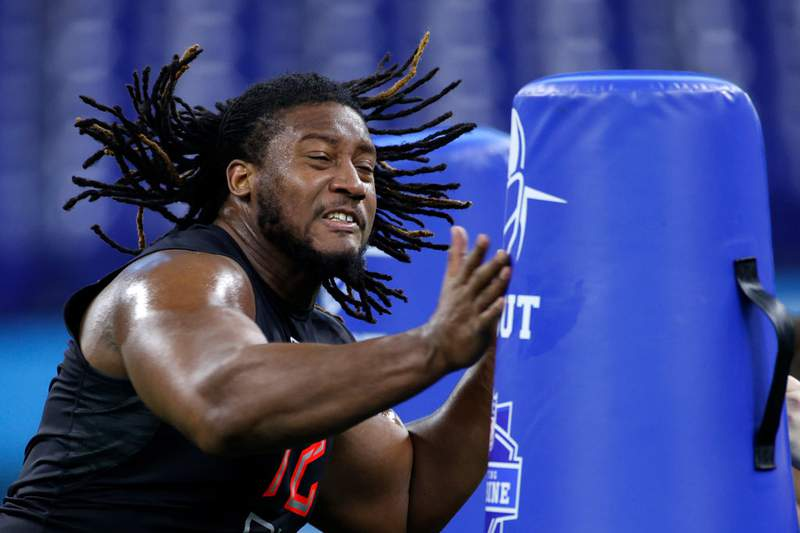 Defensive lineman Davon Hamilton of Ohio State runs a drill during the NFL Combine at Lucas Oil Stadium on February 29, 2020 in Indianapolis, Indiana. (Photo by Joe Robbins/Getty Images)