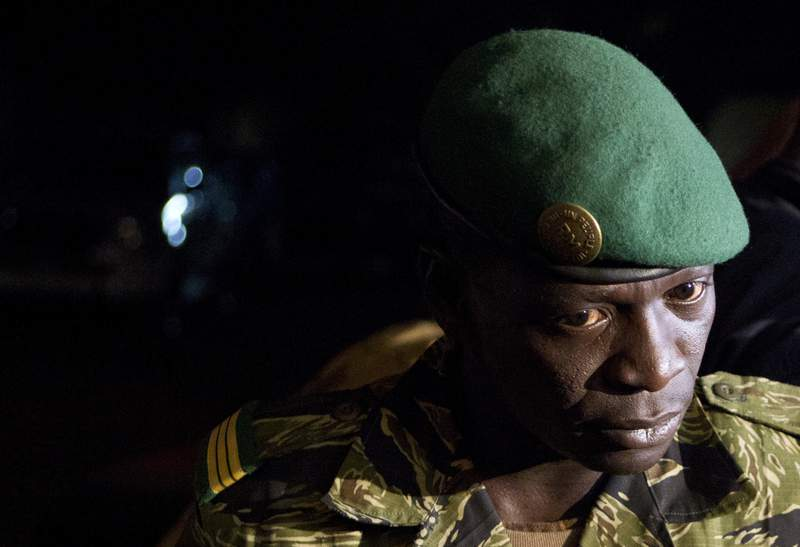 FILE - In this March 31, 2012 file photo, junta leader Capt. Amadou Haya Sanogo speaks to journalists at his headquarters in the Kati military camp, just outside Bamako, Mali.  Sanogo, who overthrew Mali's president in 2012, will no longer stand trial on charges he had 21 soldiers killed after a failed counter-coup that same year, an appeals court ruled in Bamako Monday March 15, 2021. (AP Photo/Rebecca Blackwell, File)