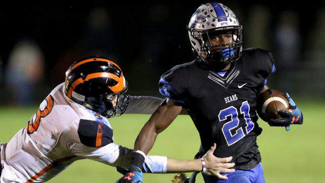 Bartram Trail running back Eric Weatherly shakes off a Spruce Creek defender in the first quarter of a Region 1-8A quarterfinal game on Nov. 8. (Ralph D. Priddy, Contributed photo)