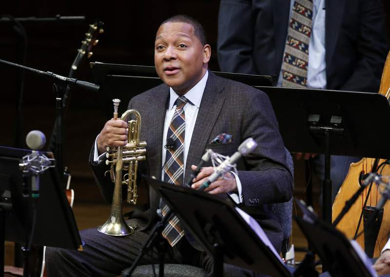 FILE - In this Jan. 30, 2014 file photo, Musician Wynton Marsalis speaks during a lecture performance at Harvard University's Sanders Theatre in Cambridge, Mass. The Louis Armstrong Educational Foundation has launched a $1 million emergency fund to support freelance New York City-area jazz musicians during the coronavirus pandemic. The fund will give one-time grants of $1,000 to jazz musicians that live in the New York City region and work regularly in the five boroughs of New York City. Marsalis, the Grammy-winning jazz icon is president of The Louis Armstrong Educational Foundation. (AP Photo/Elise Amendola, File)