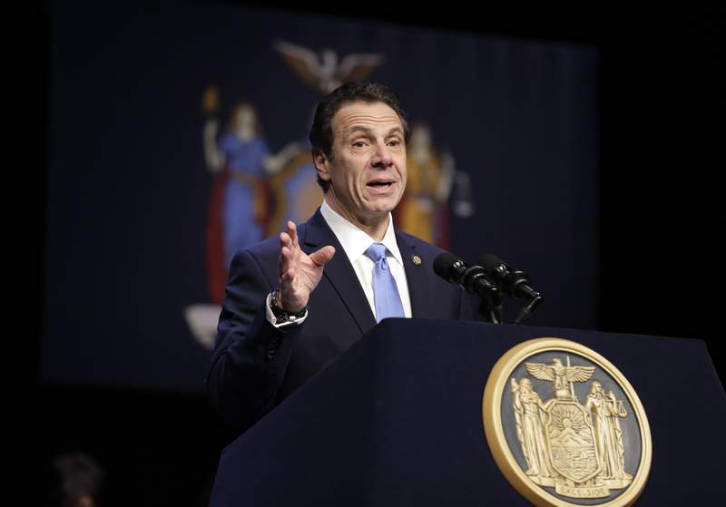 """FILE - In this Feb. 25, 2019 file photo, New York Gov. Andrew Cuomo speaks during a bill signing ceremony in New York. Cuomo says his state will file a lawsuit challenging the Trump administration's plan to block New Yorkers from enrolling in """"trusted traveler"""" programs. Federal officials say they took the step because of a new New York law barring immigrant agents from getting access to state motor vehicle records.(AP Photo/Seth Wenig, File)"""