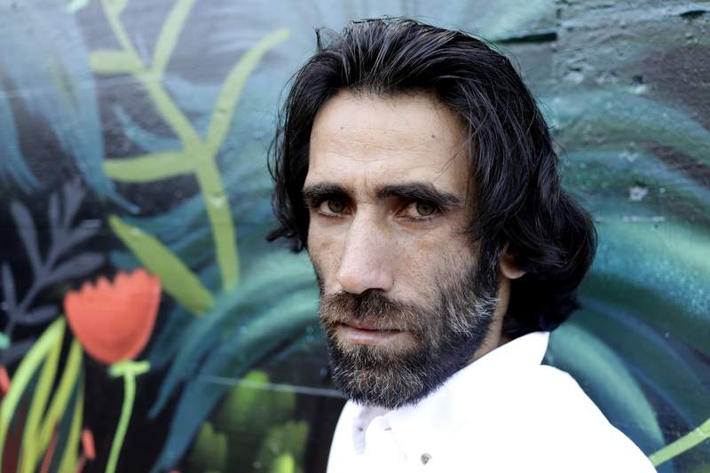 FILE - In this Nov. 19, 2019, file photo, Behrouz Boochani, the Kurdish film-maker, writer and refugee who has documented life inside the Australian offshore immigration camp on Manus Island, poses for a portrait in Christchurch, New Zealand. New Zealand immigration on Friday confirmed that Boochani, who fled Iran and then exposed Australias degrading treatment of asylum-seekers while being held against his will for six years, has been granted refugee status in New Zealand. (AP Photo/Mark Baker, File)