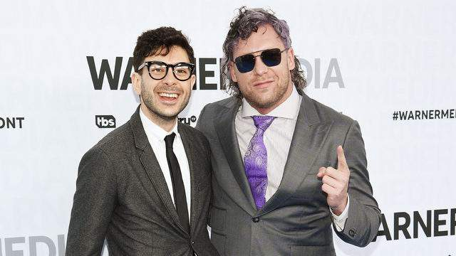 Tony Khan and Kenny Omega of TNT's All Elite Wrestling attends the WarnerMedia Upfront 2019 arrivals on the red carpet at The Theater at Madison Square Garden on May 15, 2019 in New York City.