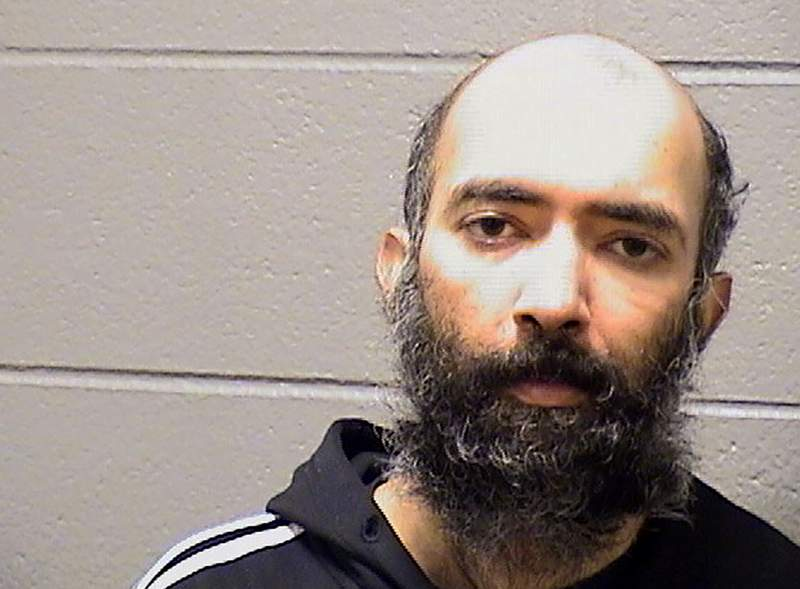 This Saturday, Jan. 16, 2021, booking photo provided by the Cook County Sheriff's Office shows Aditya Singh. Singh, of California, who told police that the coronavirus pandemic left him afraid to fly was arrested on charges that he hid in a secured area at Chicago's O'Hare International Airport for three months.  (Cook County Sheriff's Office via AP)