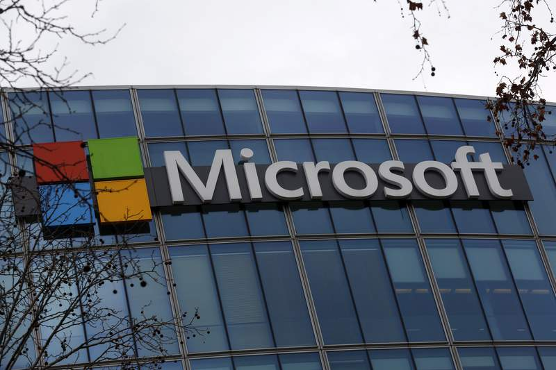 FILE - This Jan. 8, 2021 file photo shows the logo of Microsoft displayed outside the headquarters in Paris. Microsofts business beat Wall Street expectations for the first three months of 2021, thanks to ongoing demand for its software and cloud computing services during the pandemic. The company on Tuesday, April 27, 2021 reported fiscal third-quarter profit of $14.8 billion, up 38% from the same period last year. (AP Photo/Thibault Camus, file)