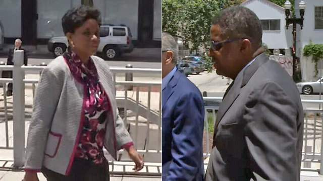 Katrina Brown, Reggie Brown arrive at U.S. Courthouse in Jacksonville for hearing.