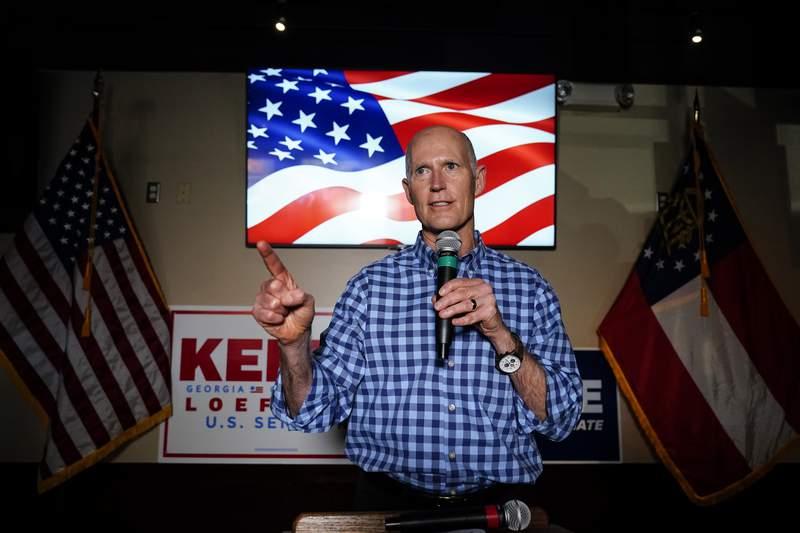 Sen. Rick Scott, R-Fla., speaks during a campaign rally for Republican candidates for U.S. Senate Sen. Kelly Loeffler and Sen. David Perdue on Nov. 13 in Cumming, Ga.