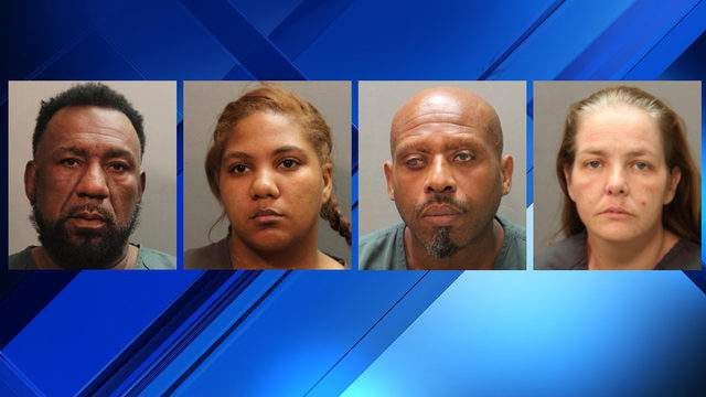 Jacksonville Sheriff's Office booking photos (from left to right) ofRoosevelt Johnson, Ladorne Parker, Ronald Gilbert and Kari Pope
