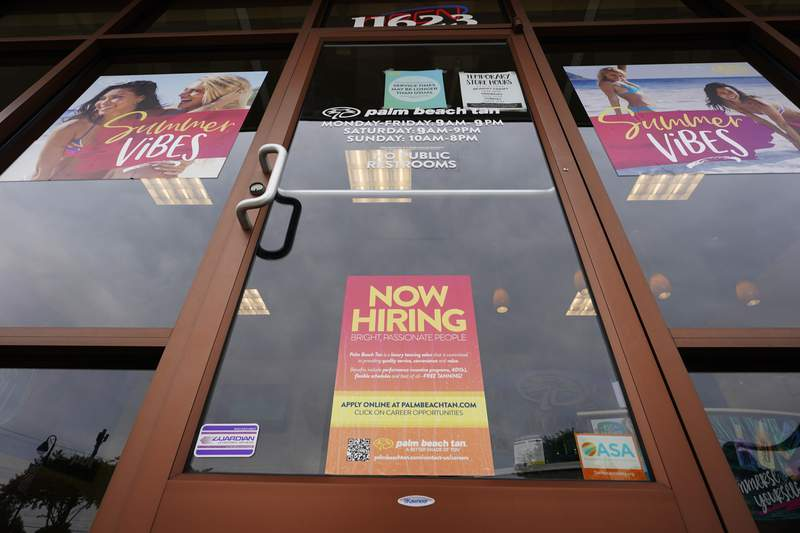 A Now Hiring sign at a business in Richmond, Va., Wednesday, June 2, 2021.  U.S. employers posted a record 9.3 million job openings in April as the U.S. economy reopens at break-neck speed. Openings were up 12% from 8.3 million in March.   (AP Photo/Steve Helber)