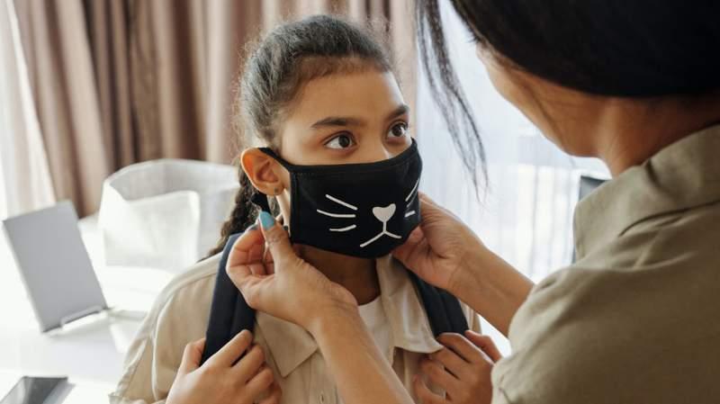 Girl in face mask.