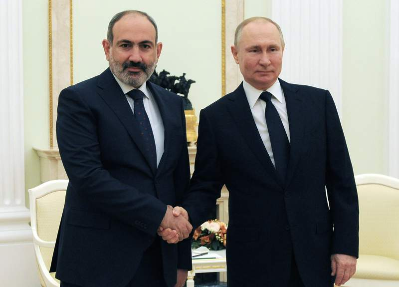 FILE - In this Wednesday, April 7, 2021 file photo, Russian President Vladimir Putin, right, and Armenian Prime Minister Nikol Pashinyan pose for a photo during their meeting in Moscow, Russia. Armenia has on Friday, May 14, 2021 asked a Russia-dominated security pact of former Soviet nations to look into its tensions with Azerbaijan in the wake of their armed conflict over Nagorno-Karabakh. (Mikhail Klimentyev, Sputnik, Kremlin Pool Photo via AP, File)