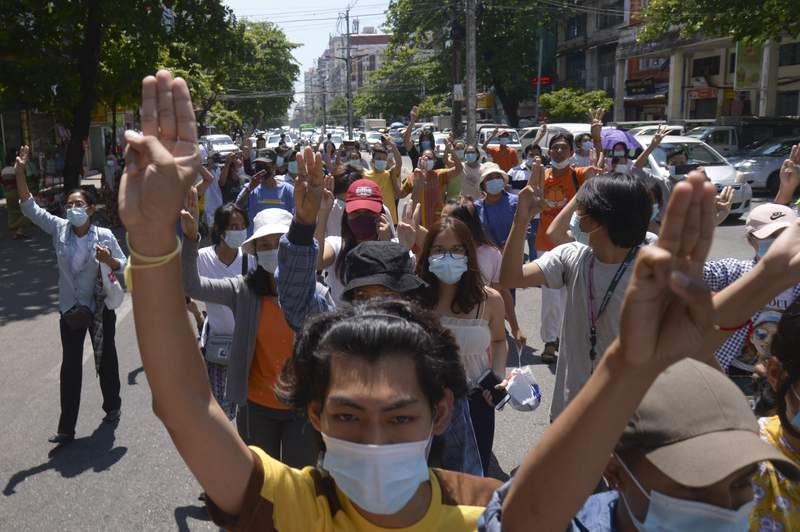 Anti-coup protesters flash the three-finger salute during a rally in Yangon, Myanmar on Tuesday May 4, 2021. The ruling junta continues to face a challenge in the cities and towns of Myanmar, where street protests are still being held more than three months after it seized power.(AP Photo)