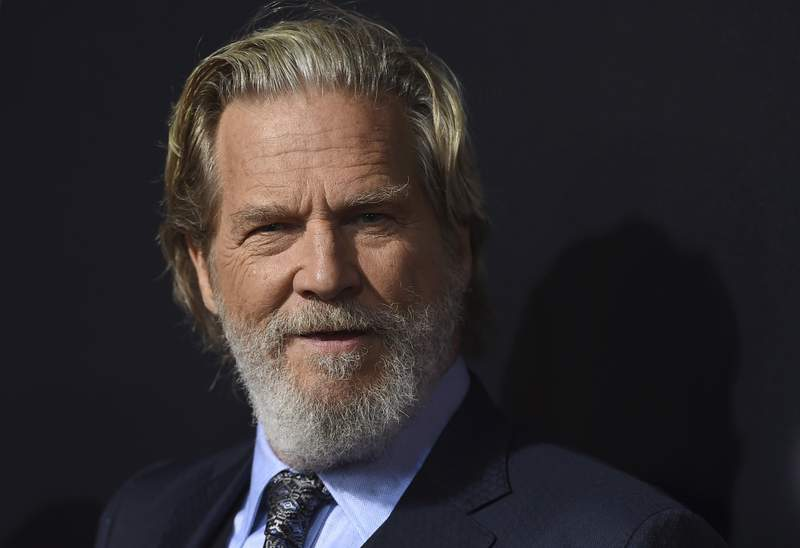 """File-This Sept. 22, 2018, file photo shows cast member Jeff Bridges arriving at the Los Angeles premiere of """"Bad Times at the El Royale"""" at TCL Chinese Theatre. Bridges says he is being treated for lymphoma and his prognosis is good. The actor channeled his The Dude character from The Big Lebowski in a statement on social media about the diagnosis Monday, Oct. 19, 2020. He said he understands the disease is serious and expressed gratitude to his family, friends, and medical team. (Photo by Jordan Strauss/Invision/AP, File)"""