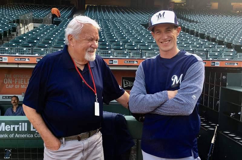 In this Aug. 21, 2017, photo, baseball scout Gary Hughes, left, talks with Milwaukee Brewers managers Craig Counsell before a baseball game in San Francisco. Hughes' son, Michael, is married to Counsell's sister. Hughes, a beloved longtime professional scout for numerous big league organizations during a 54-year career, has died in Northern California after a battle with cancer. He was 79. Hughes was a regular at Bay Area ballparks in recent years working for the Red Sox and Diamondbacks. Arizona announced his death in a statement Saturday, Sept. 19, 2020, saying he died earlier in the day. (AP Photo/Janie McCauley)