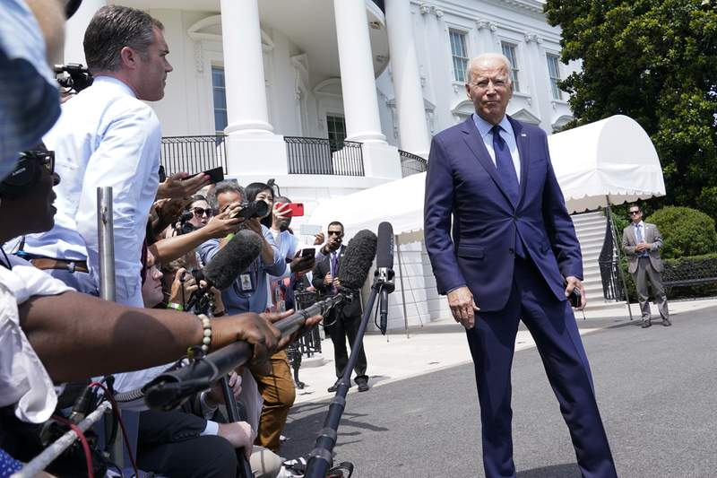 President Joe Biden walks past reporters as he heads to Marine One on the South Lawn of the White House in Washington, Friday, July 16, 2021, to spend the weekend at Camp David. (AP Photo/Susan Walsh)