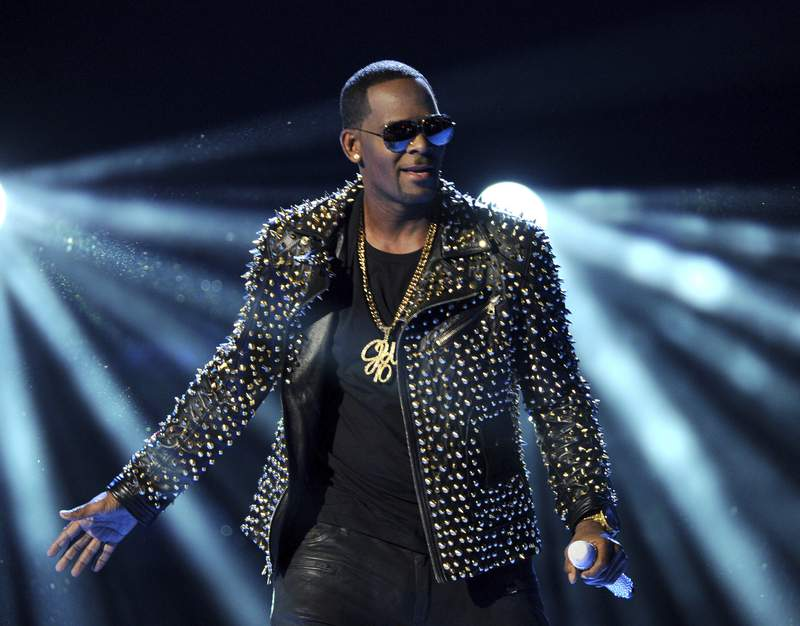 FILE - R. Kelly performs at the BET Awards on June 30, 2013, in Los Angeles. R. Kellys new lawyers are asking a judge to postpone his Aug. 9, 2021, sex trafficking trial in New York City, arguing they havent had enough time to prepare because hes under a mandatory jail quarantine. (Photo by Frank Micelotta/Invision/AP, File)